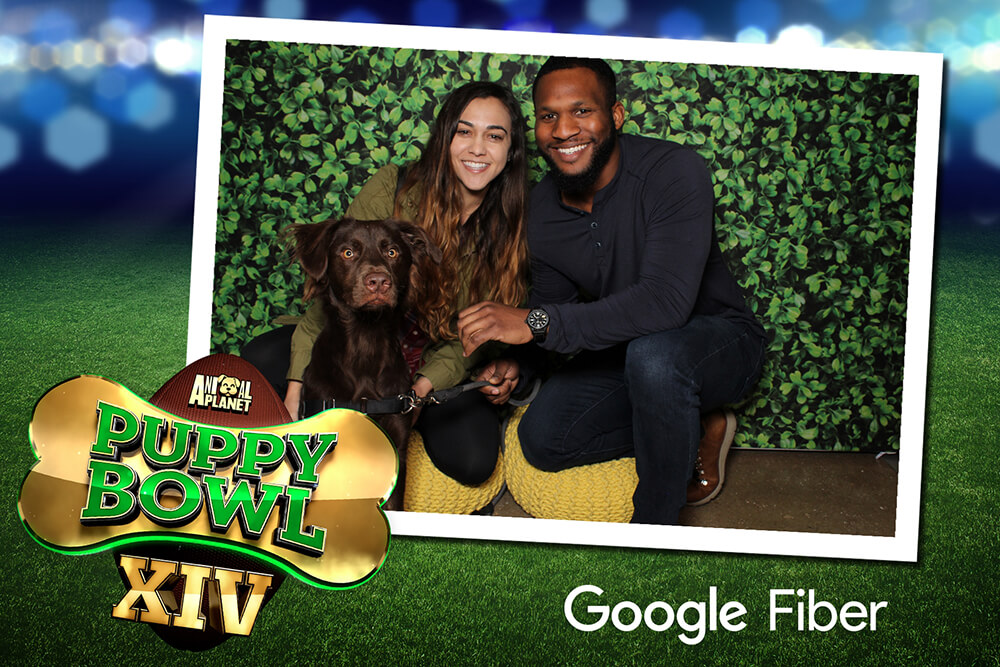 Photo Booth Print with a couple posing with their dog for the Puppy Bowl sponsored by Google Fiber