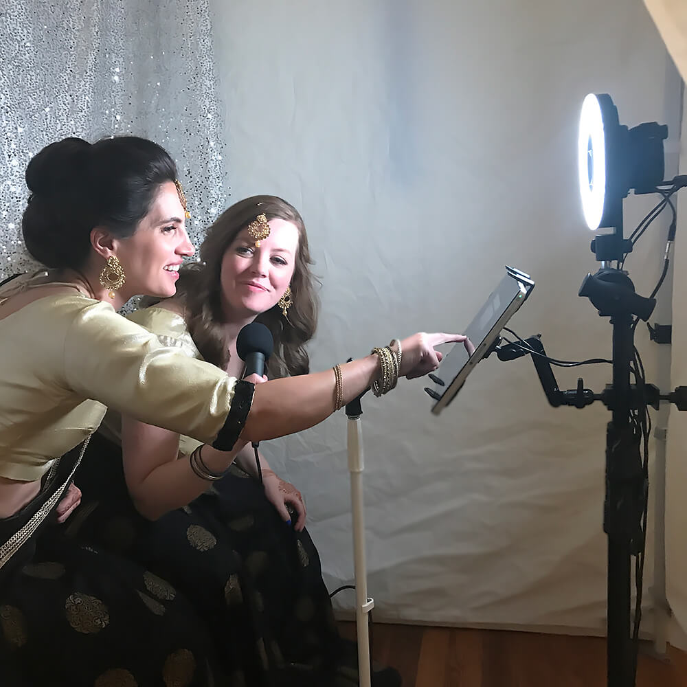 Two women in the video confessional booth